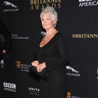 Dame Judi Dench keeps the spark alight