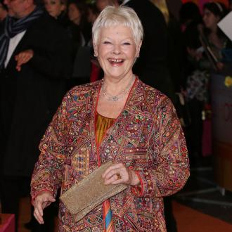 Dame Judi Dench plants trees in tribute to friends and relatives