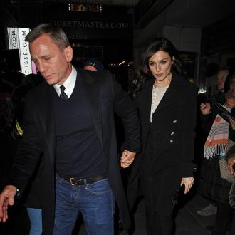 Daniel Craig Grabs Phone Off Fan