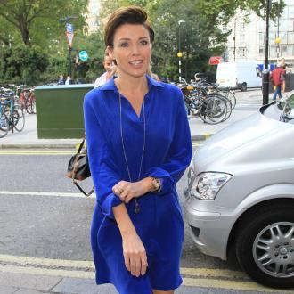 Dannii Minogue dating Swiss singer Adrian Newman