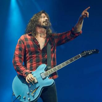 Dave Grohl takes a tumble after downing Bud Light beer