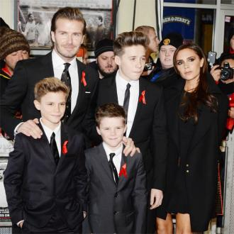 David And Victoria Beckham's Santa Outing