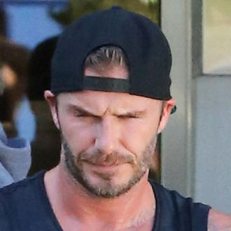 David Beckham Supports 'Brother' Lamar Odom