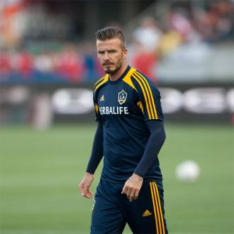 David Beckham Hides From Female Fans