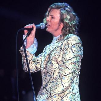 David Bowie's long-serving guitarist John Hutchinson dies
