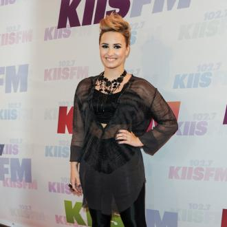 Demi Lovato Is 'Competitive' With Miley Cyrus And Selena Gomez