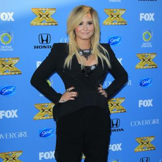 Demi Lovato Wants To Be Godmother To Simon Cowell's Baby