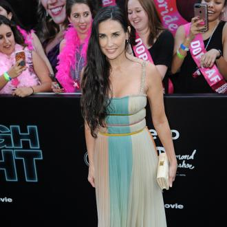Demi Moore celebrates losses