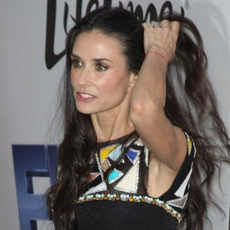 Demi Moore Celebrates Low Key 50th Birthday