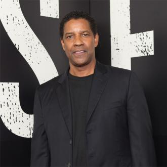 Denzel Washington thanks hairstylist Larry Cherry for signature look