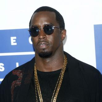 Diddy jumped out of a plane and into Playboy Mansion