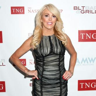 Dina Lohan: Me and my mystery man are just 'good friends'