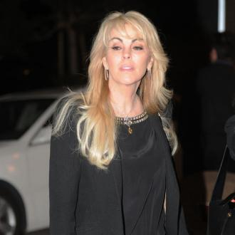 Dina Lohan asks for chair for handbag