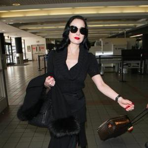 Dita Von Teese Slams Smoking