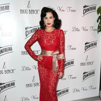 Dita Von Teese relies on gun tool to ease he back pain