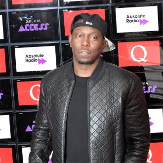 Dizzee Rascal distributes food parcels