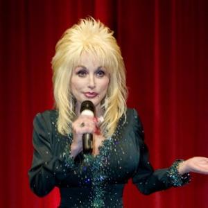 Dolly Parton Anchored By Husband