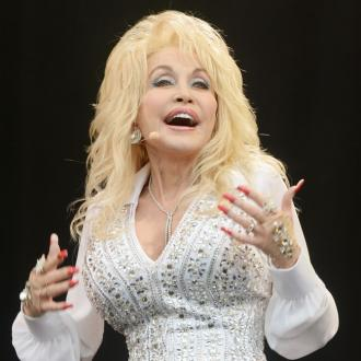 Dolly Parton stopped meetings so men could stare at her boobs