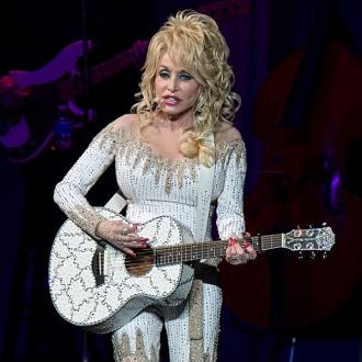 Dolly Parton jokes she's worn out her plastic surgeons
