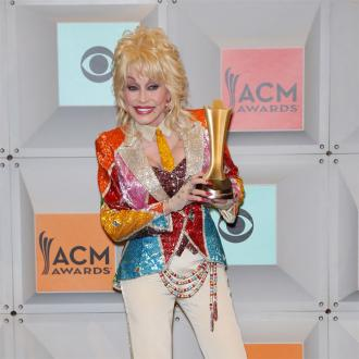 Dolly Parton decorates scars with tattoos