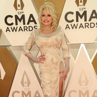 Dolly Parton's heart is 'broken' following the death of Kenny Rogers