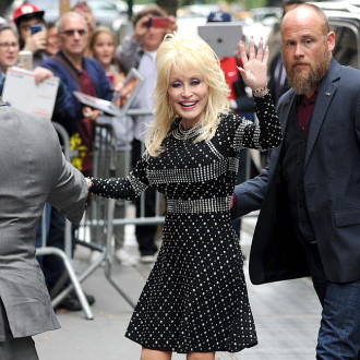 Dolly Parton felt like a 'mad scientists' creating her perfume