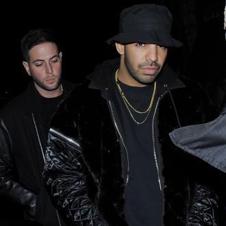 Drake Gets Emoji Tatoo