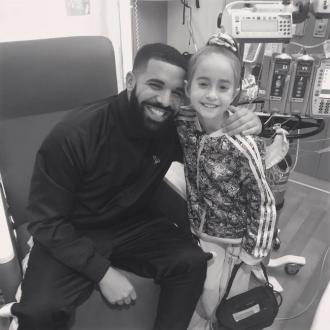 Drake surprises young fan after heart transplant