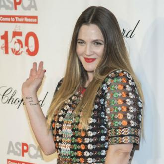 Drew Barrymore doesn't have time to apply her make-up