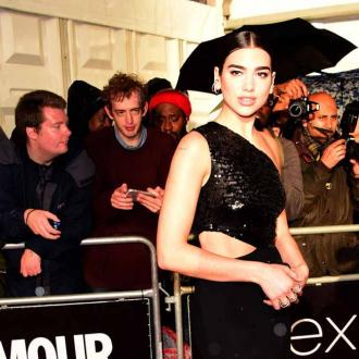Dua Lipa does a 'secret handshake' before she goes on stage