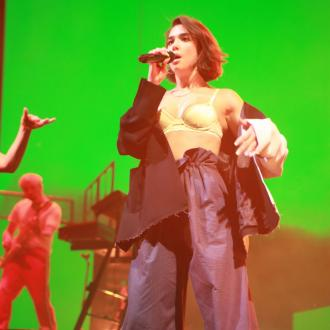 Dua Lipa Bursts Into Tears After Cutting Show Short Due To Ear Infection