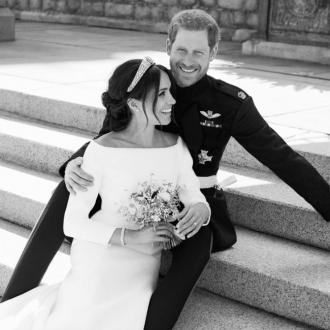 Prince Harry And Meghan Markle 'Exhausted' In Official Photo
