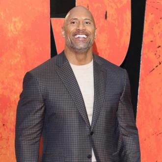 Dwayne Johnson surprises stuntman with a gift