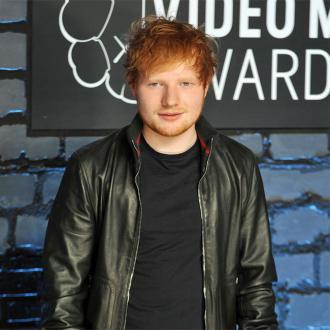 Ed Sheeran Celebrates With Sausages