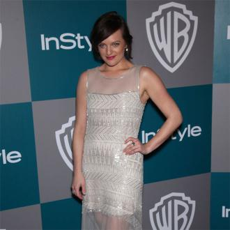 Elisabeth Moss sick of vintage clothes
