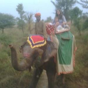 Elizabeth Hurley Rides An Elephant
