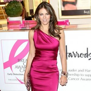 Elizabeth Hurley Is 'Mama' To Parrot