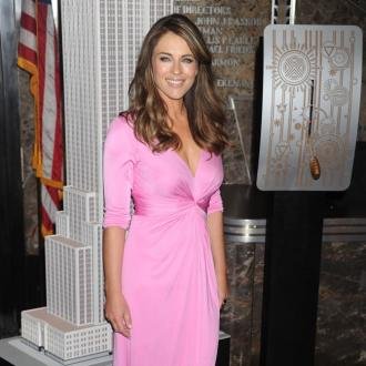Elizabeth Hurley Gets Swimwear Line Advice From Shane