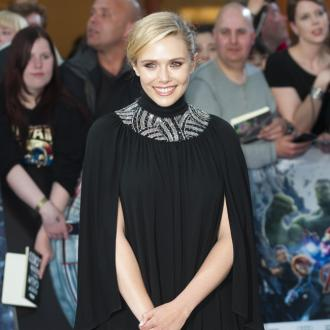 Elizabeth Olsen Says Scarlett Johansson Is 'The Coolest Chick'