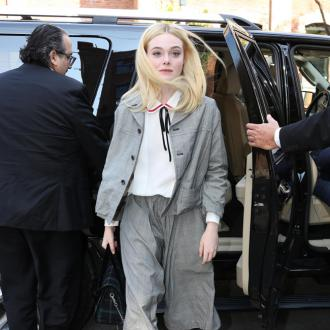 Elle Fanning felt pressured to compete with sister Dakota