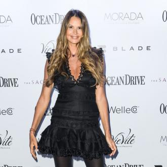 Elle Macpherson wears white for New Years