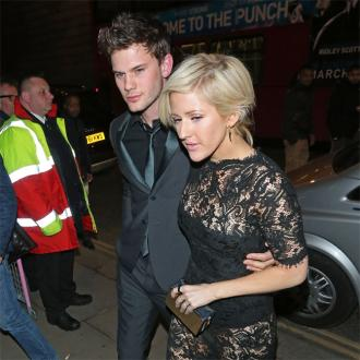 Ellie Goulding and Jeremy Irvine kiss at BRITs party