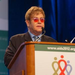 Elton John: Cure Aids With Love
