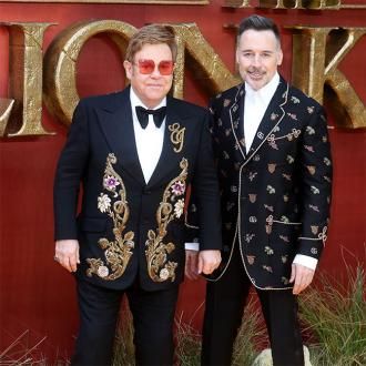 Elton John treasures cock rings Eminem gave him as wedding present