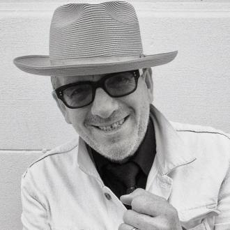 Elvis Costello drops new track No Flag