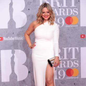Emily Atack loves her 'womanly body'