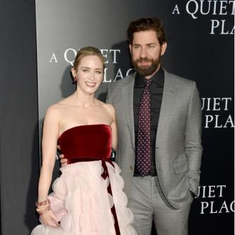 Emily Blunt and John Krasinski can't agree who made the first move