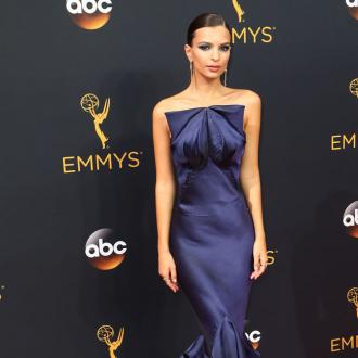 Emily Ratajkowski believes 'nothing's better' than a black trench coat