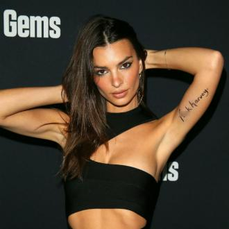 Emily Ratajkowski protests Harvey Weinstein settlement