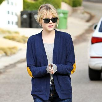 Emma Stone Laughs At Style Icon Tag